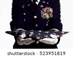 army soldier presenting folded... | Shutterstock . vector #523951819