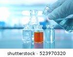 bottle and flask ans orange... | Shutterstock . vector #523970320
