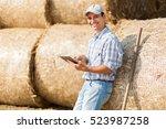 Farmer Holding A Tablet