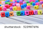 new habits words on wooden table | Shutterstock . vector #523987696