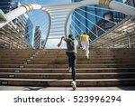 two man running upstairs... | Shutterstock . vector #523996294