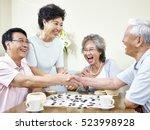senior asian men shaking hands  ... | Shutterstock . vector #523998928