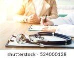 doctor and patient | Shutterstock . vector #524000128