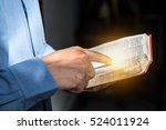 a man reading the holy bible. | Shutterstock . vector #524011924