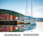 bryggen street with boats in... | Shutterstock . vector #524034334