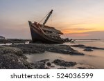 An Old Shipwreck On Beach