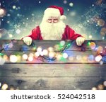 Happy Santa Claus Holding Blan...