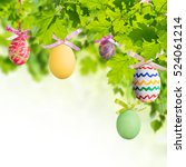 easter eggs in green branches... | Shutterstock . vector #524061214