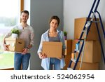 happy young couple unpacking or ... | Shutterstock . vector #524062954