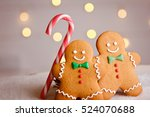 two gingerbread man with candy... | Shutterstock . vector #524070688