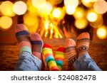 family in christmas socks near... | Shutterstock . vector #524082478
