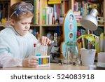 cute school kid boy sitting at... | Shutterstock . vector #524083918