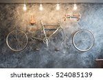 vintage bicycle on the wall... | Shutterstock . vector #524085139