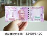 man hold 2000 rupee banknote...   Shutterstock . vector #524098420
