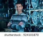 man selling alloy wheel rims.... | Shutterstock . vector #524101870