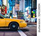 Small photo of Yellow cabs in Manhattan, NYC. The taxicabs of New York City at night Time Square.