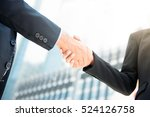 Small photo of Businessman making handshake with a businesswoman in blur building background - greeting , dealing, merger and acquisition concepts
