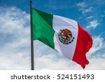 Flag of mexico over blue cloudy ...