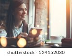 smiling woman in cafe using... | Shutterstock . vector #524152030