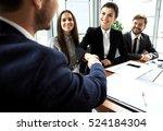 business people shaking hands ...   Shutterstock . vector #524184304