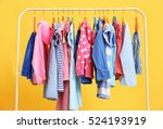 Stock photo clothes hanging on rack closeup 524193919