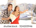 amazed couple of tourists... | Shutterstock . vector #524205946