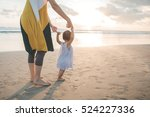 Mother Teaching Baby To Walk O...