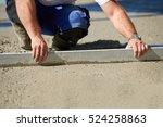 worker screeding cement floor... | Shutterstock . vector #524258863