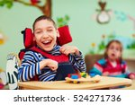 Cheerful boy with disability at ...