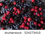 berries mix on a gray abstract... | Shutterstock . vector #524273410