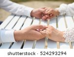 couple holding hands at white... | Shutterstock . vector #524293294