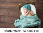 sweet newborn baby sleeps in a... | Shutterstock . vector #524300140
