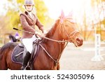 young rider woman riding bay... | Shutterstock . vector #524305096