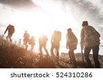 group of hikers walking on a... | Shutterstock . vector #524310286