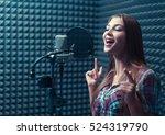 singing girl in recording studio | Shutterstock . vector #524319790