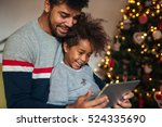 dad and daughter watching... | Shutterstock . vector #524335690