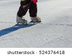 Child Feet Learning To Skate O...