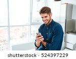 picture of young man using a... | Shutterstock . vector #524397229