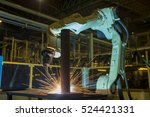 robot is welding assembly... | Shutterstock .eps vector #524421331