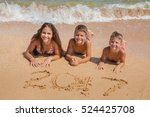 three smiling kids on the beach ... | Shutterstock . vector #524425708