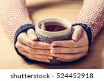 hot mug of tea warming woman's... | Shutterstock . vector #524452918