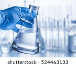 Laboratory Beaker In Analyst\'s...