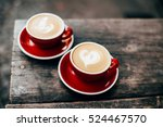 two red cups of cappuccino with ... | Shutterstock . vector #524467570