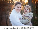 mother and little son in spring ... | Shutterstock . vector #524475970