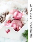 Pink Christmas Baubles In A...