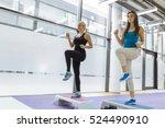 Small photo of Beautiful women exercising aerobics in nice fitness club
