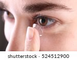 woman putting contact lens in... | Shutterstock . vector #524512900