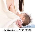 asian baby drinking breastmilk | Shutterstock . vector #524522578