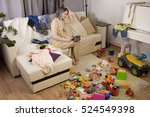 mother sitting on the couch.... | Shutterstock . vector #524549398