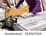 worker using saw machine to... | Shutterstock . vector #524567434